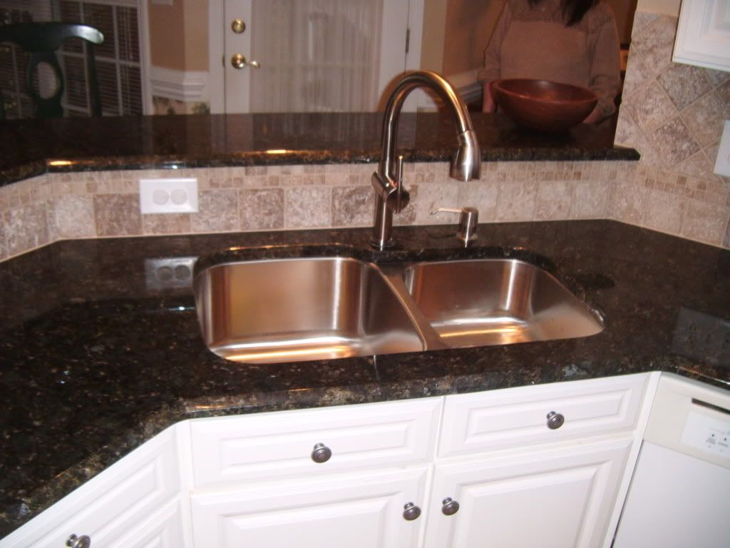White Granite Kitchen Sink Similar Layout With Backsplash Behind The Sink And A Stainless