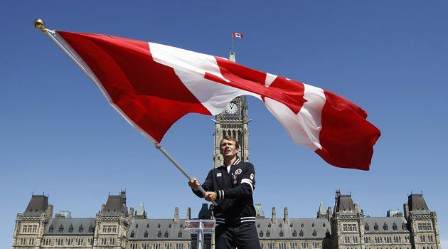 Triathlete Simon Whitfield Waves The Canadian Flag After Being Named Canada S Flag Bearer For The Opening Ceremony At The L Canadian Flag Olympics Olympic Flag