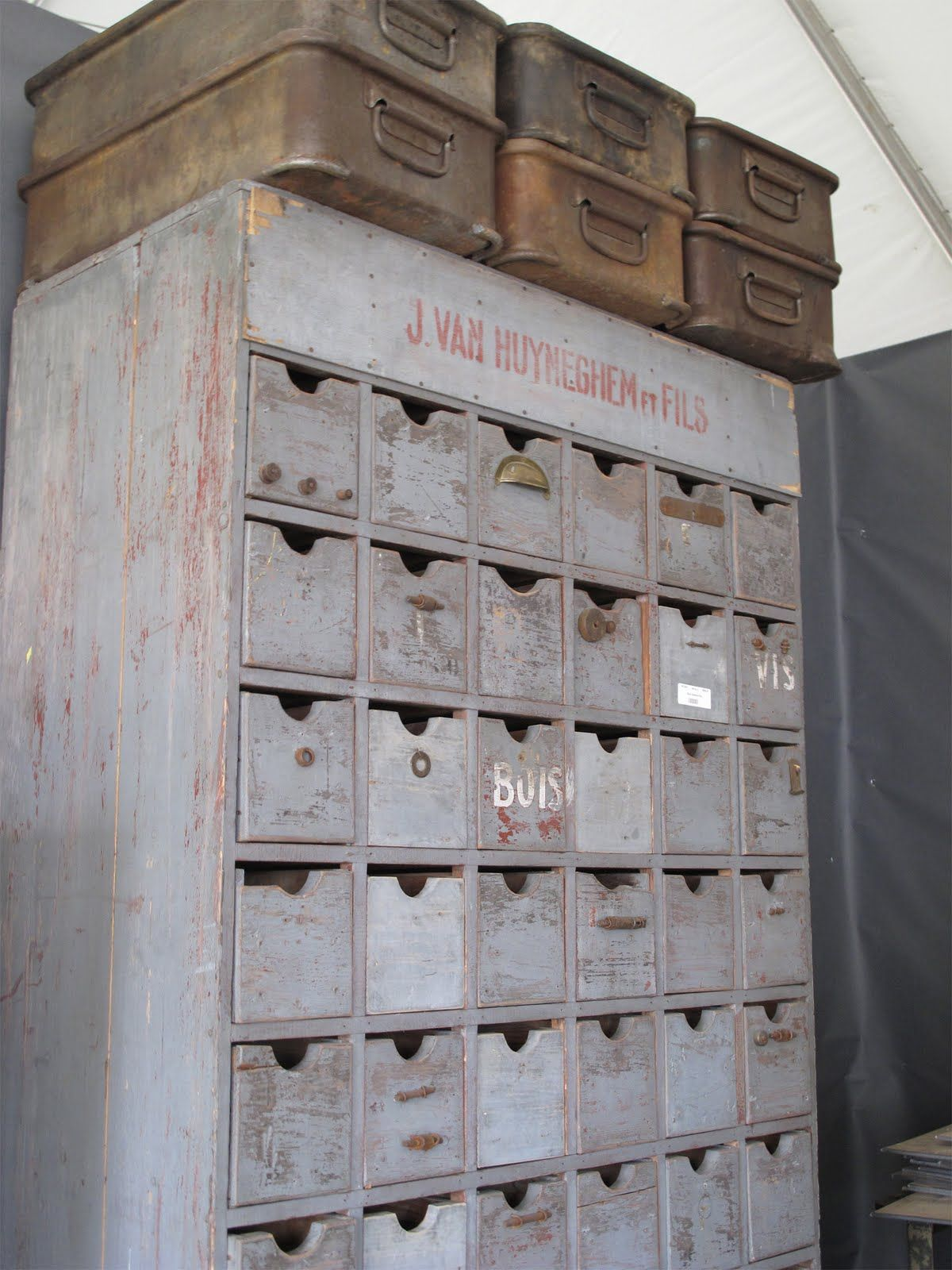 Old Chipped Blue Cabinet.. filled with mini cubbies and drawers...old metal file boxes on top.