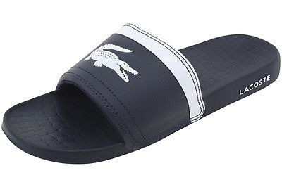 7a290c03af58 Lacoste Men s Dark Blue White Fraisier BRD1 Fashion Slide Sandals Shoes