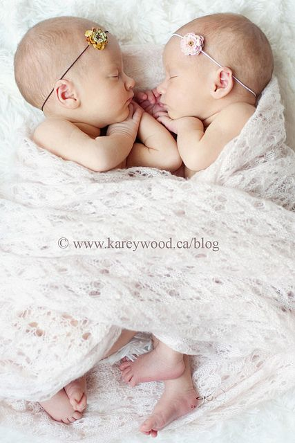 Twin little girls wrapped together