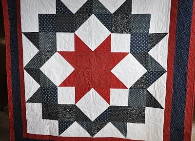 Quilt of Valor - Ring Around the Star  Pieced and Quilted by Dianne Kartchner  May 2010