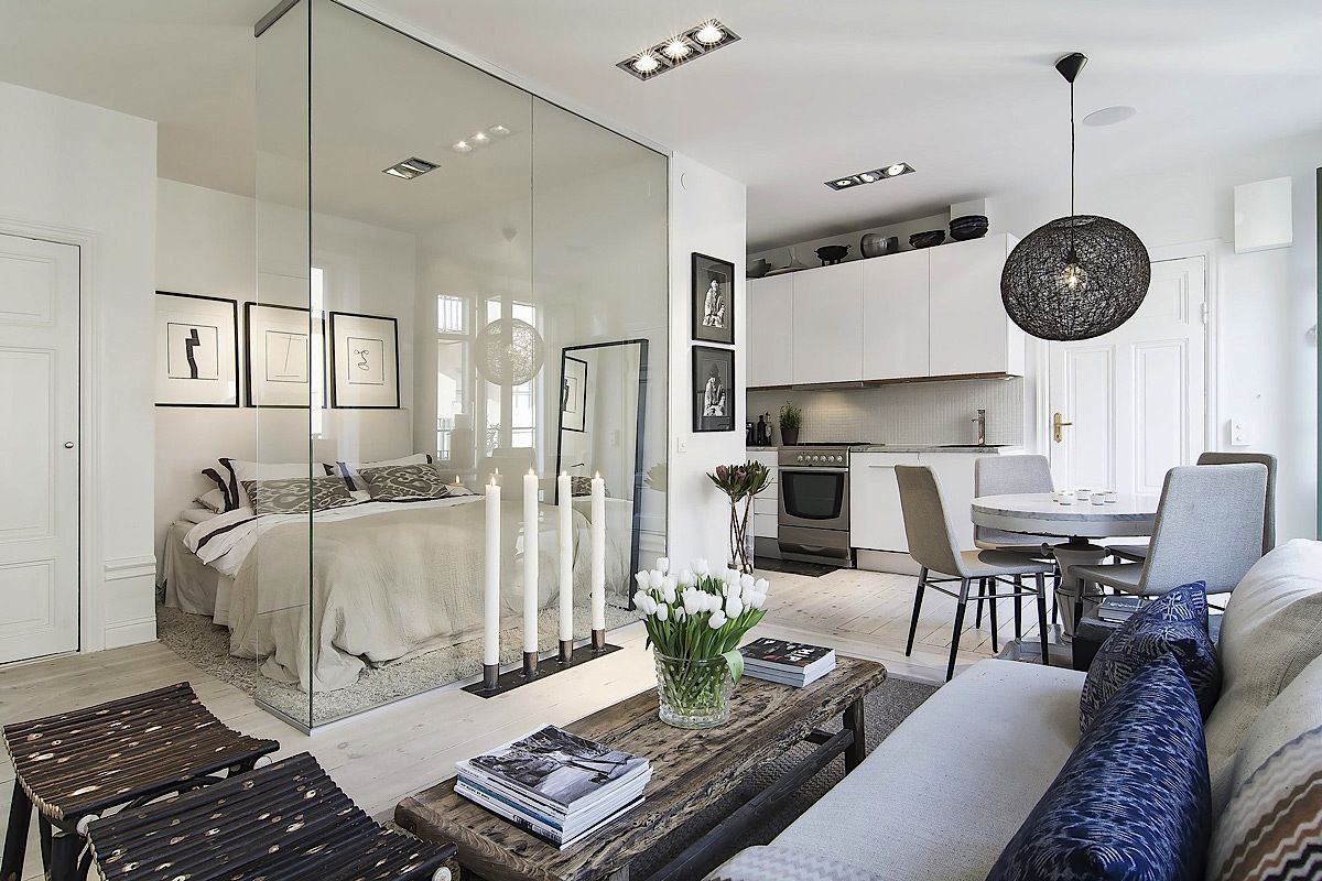 glass wall bw #bedroom and living space is a great idea for a small apartment/studio