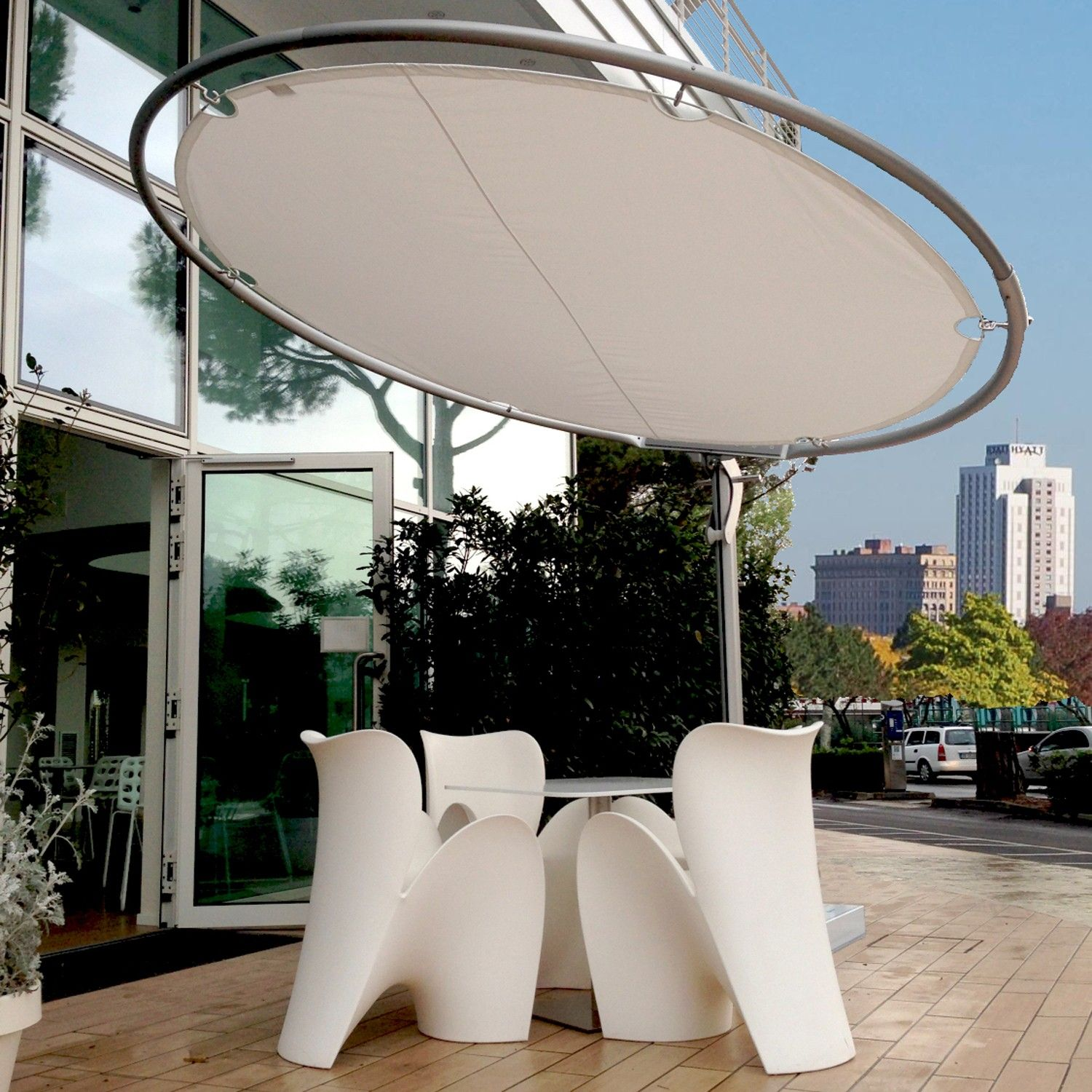 Eclipse Round Umbrella from Umbrosa -- a sleek contemporaryumbrella. It's circular shade can rotate 360 degrees