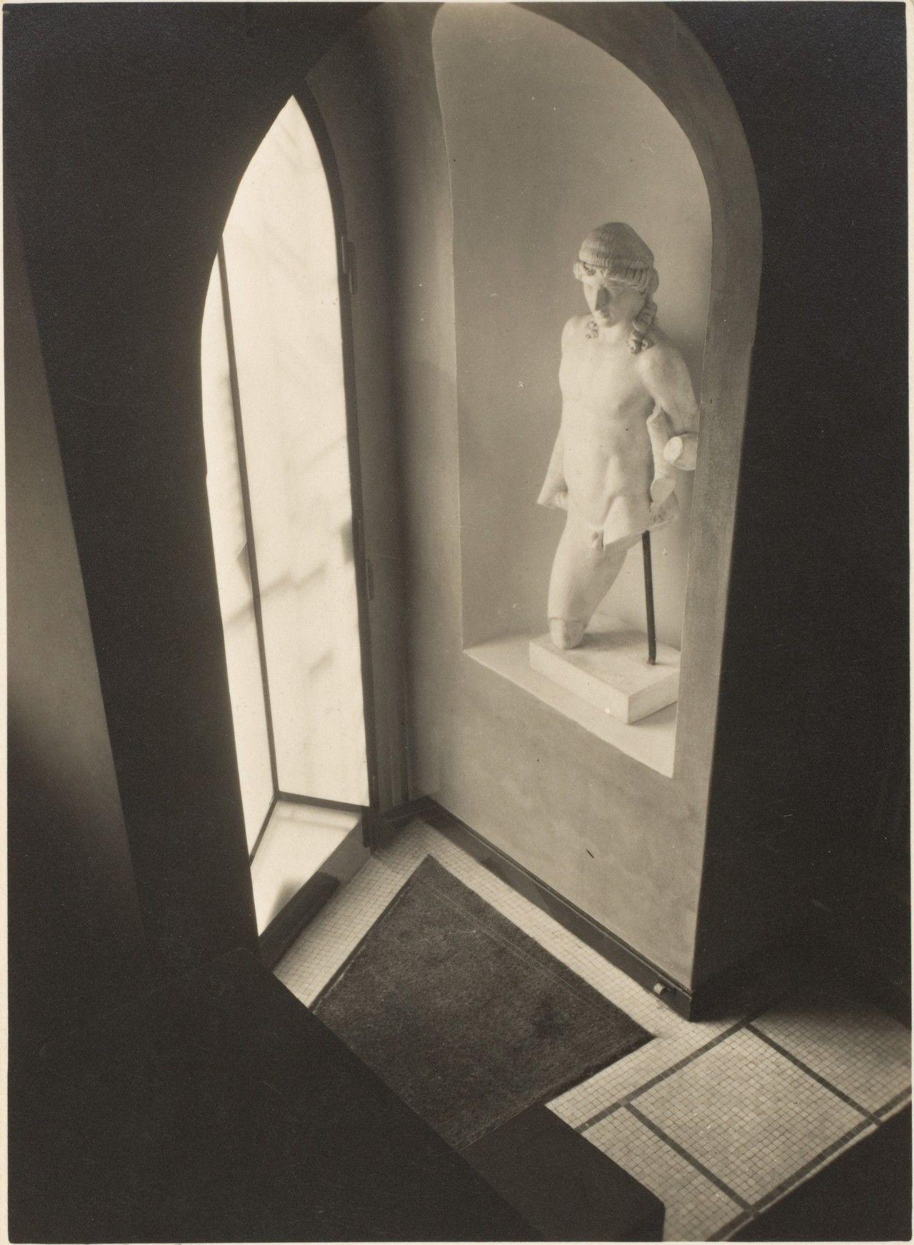 André Kertész(Hungarian/American, 1894-1985)Interior with sculpture, 1920s. Gelatin silver print.