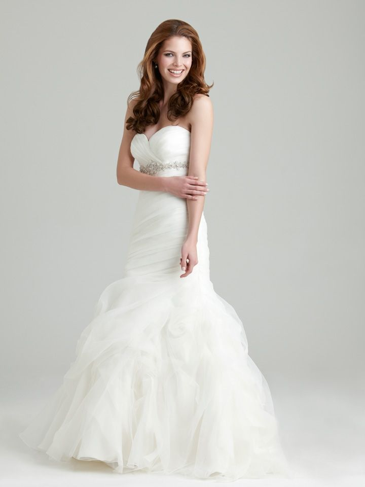Style: 2550 An understated strapless, slim fitted gown. Soft organza ...