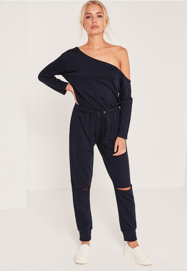 Nail the navy in this jumpsuit for a throw-on-and-go style - featuring ripped deets for a grunge flair and an off the shoulder style.