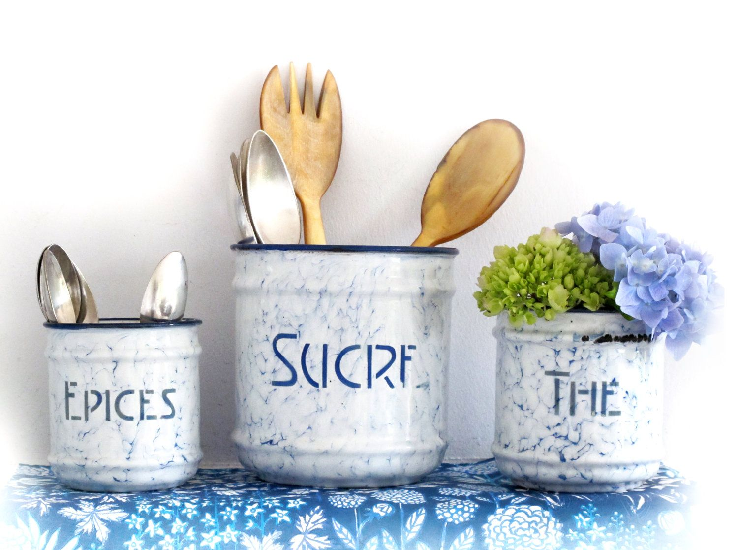 3 french vintage enamel tin container - sucre , the and epices, blue and white enamelware, graniteware. $22.00, via Etsy.