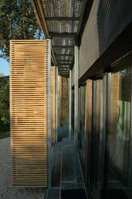 Passive House, Bessancourt, France by: Karawitz Architecture. Vertical + Horizontal Louvers