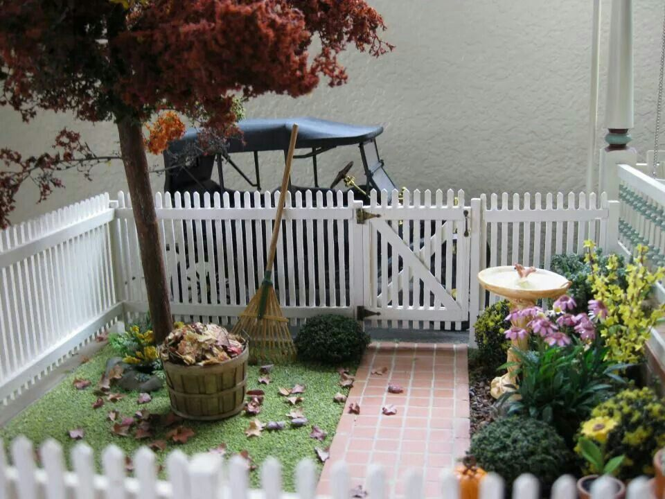 dollhouse yard with picket fence
