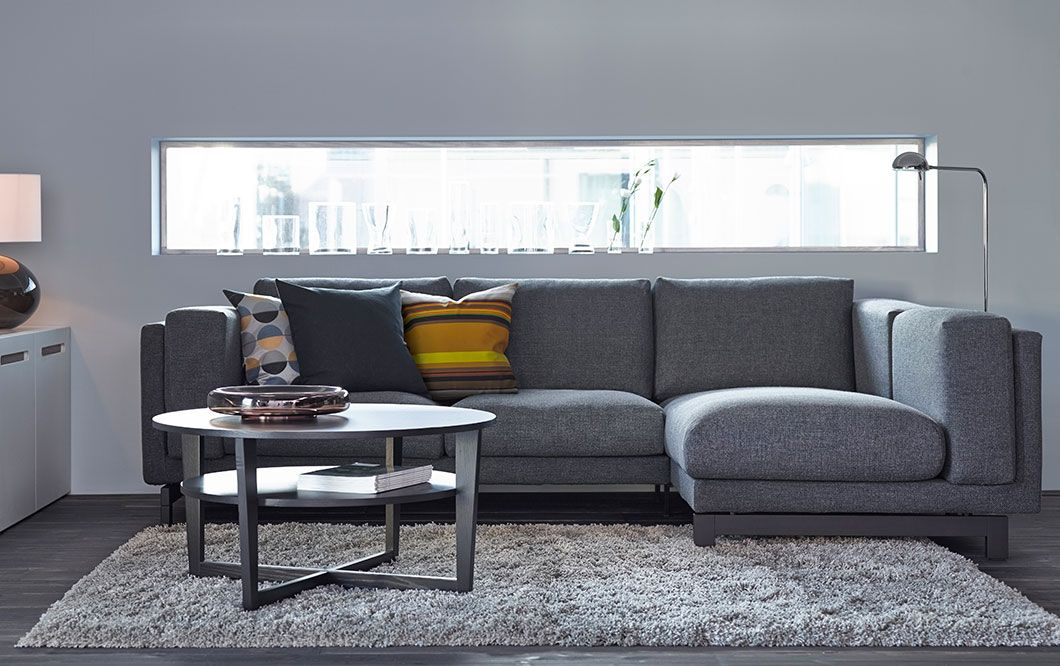 A Living Room With Two Seat Sofa Chaise Longue In Dark Grey Cover And Black Brown Coffee Table
