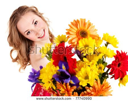 Beautiful  young woman holding  flowers.