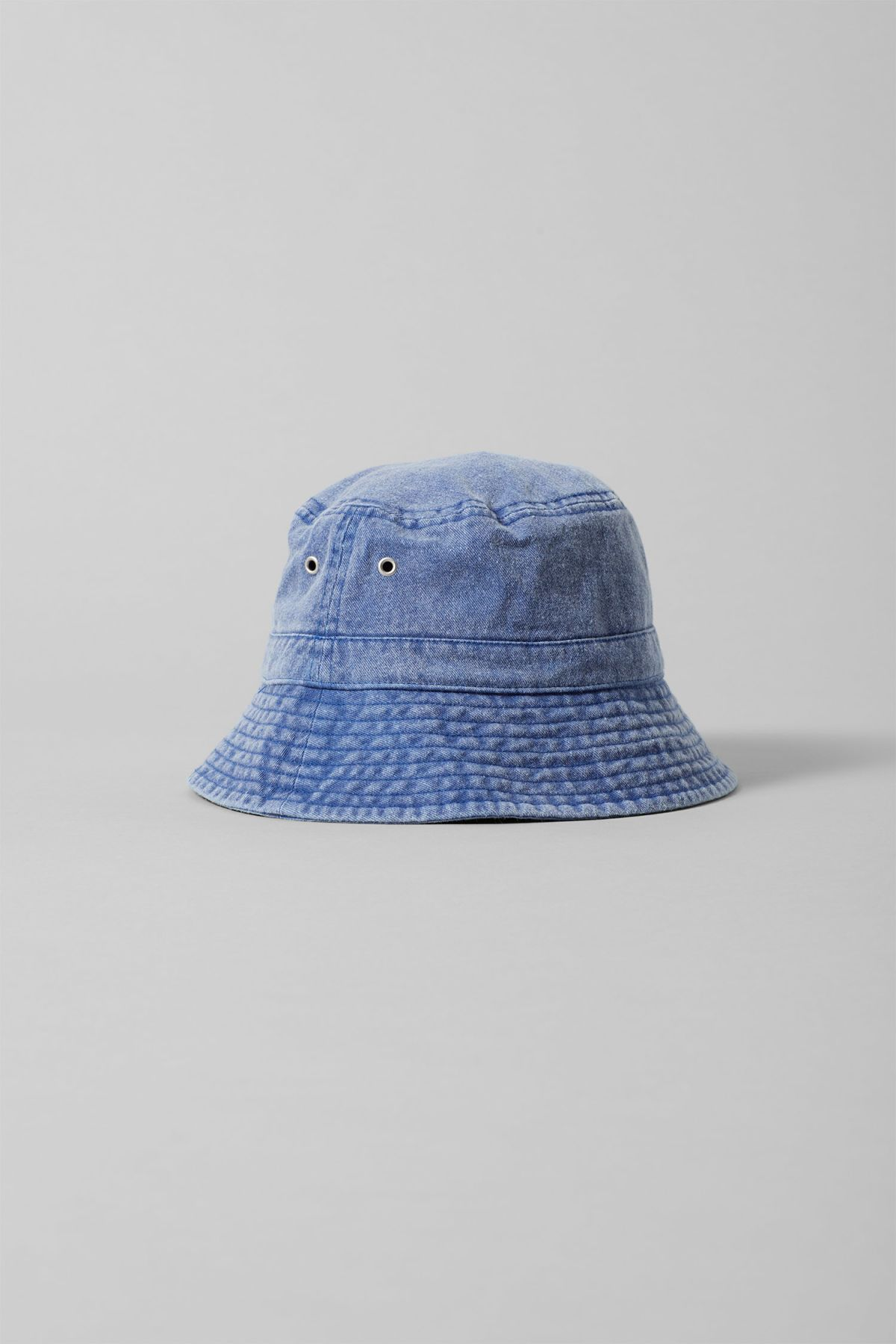 6655106e90b84 The Altitude Bucket Hat is a stand-out accessory crafted in soft denim with  a subtly washed out finish.