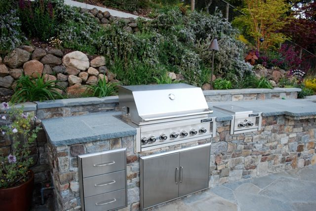 built in outdoor kitchen modern outdoor kitchen built into retaining wall would be great to do when we redo our temporary