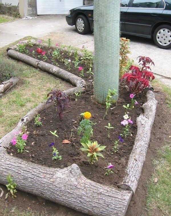 Natural Logs Around Raised Flower Bed Garden Edging 400 x 300