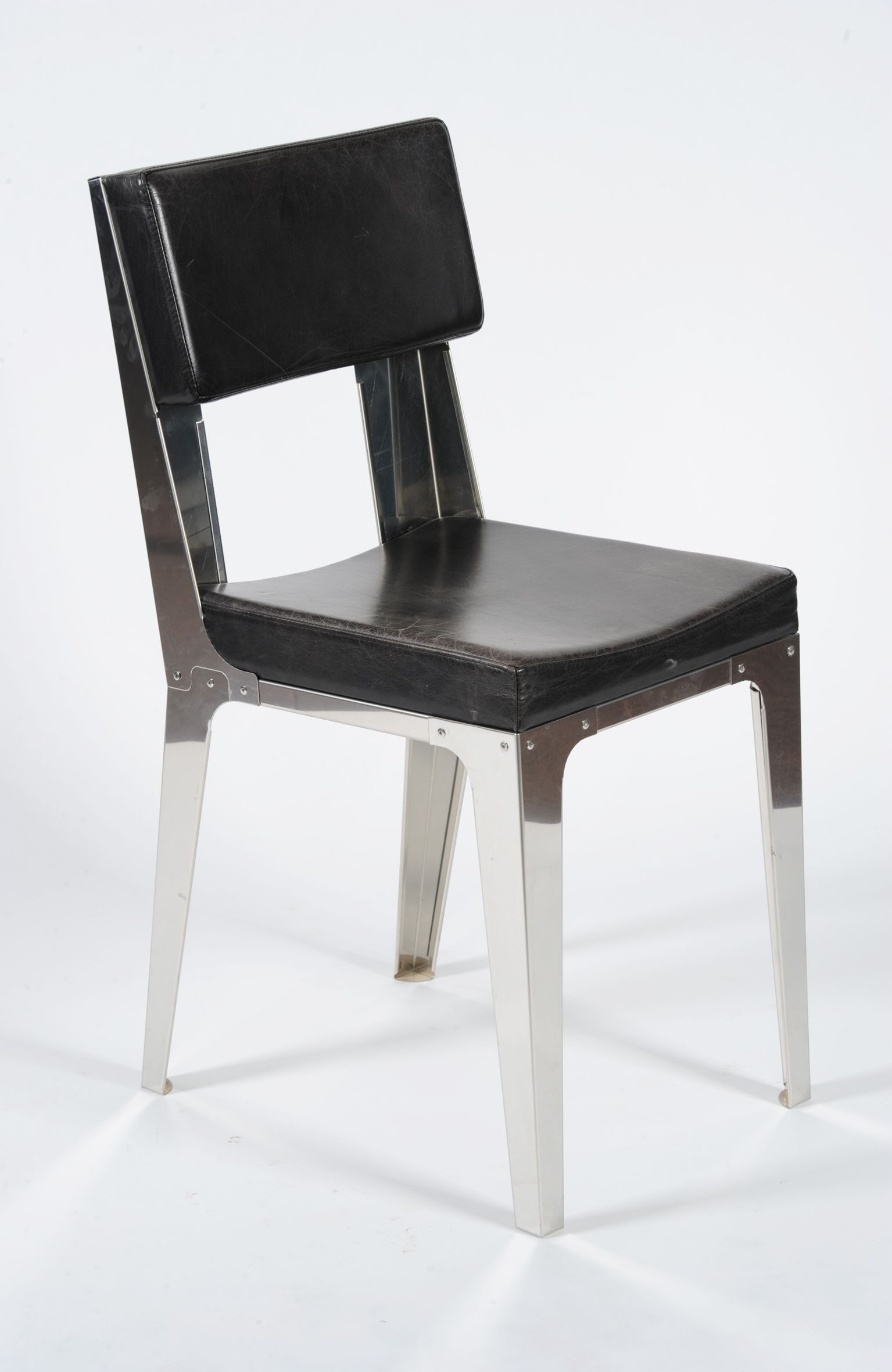 Stainless Steel Glossy Chair with Leather Upholtery / Año: 2004 / Vendidas: Ninguna
