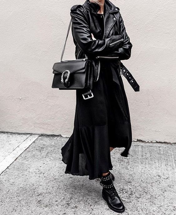 all black outfit ideas: black maxi dress, black leather moto jacket, combat boots, street style