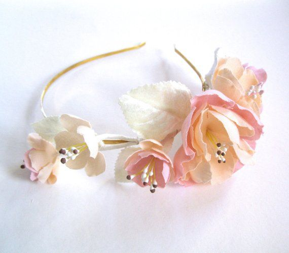 English garden flower headband ivory peach pink off white gold is part of English garden White - shaped cotton petals  The chic color combination of light pink, pale peach, and off white flowers feature vintage stamen centers  Vintage style velvet leaves in ivory finish this lovely and one of a kind piece The flower side detail about 7 5 inches long and 3 inches wide (largest flower is 2 5 inches by 3 inches)  It is attached to a skinny gold metal headband  Piece shown in pictures is ready to ship!Custom colors, sizes, etc  available in this design, just ask) Last photo shows other one of kind flower combs in this collection that are available for purchase
