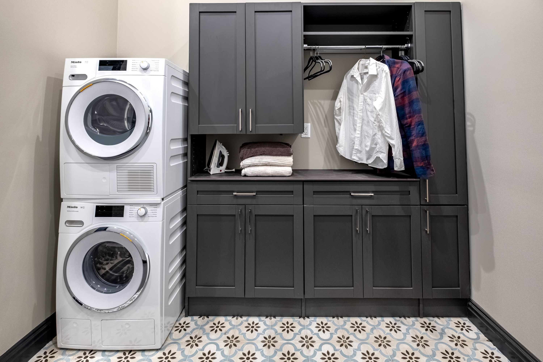 Designer Laundry Room In 2020 Closet Storage Systems Custom Closet Storage Laundry Room Storage Solutions