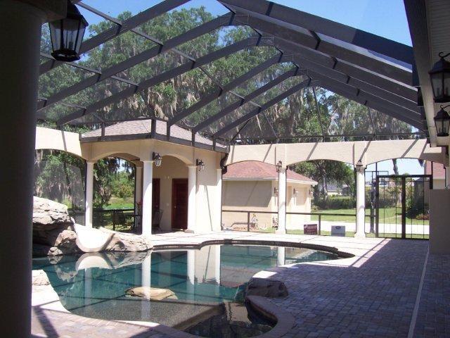 Pool Enclosure With Rock Slide And Restrooms Luxury Swimming Pools Luxury Pools Backyard Pool Landscaping