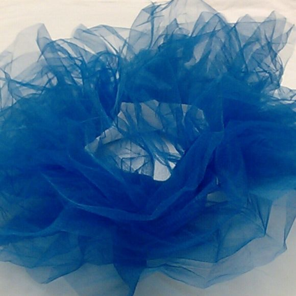 Royal Blue Tutu The 6-inch layers of this organza-tulle fabric rave tutu make for a very flirty, flowy and playful accessory, but it is also very sturdy and is assembled to a very strong and flexible band of elastic that fits sizes XS-XL. Skirts Mini