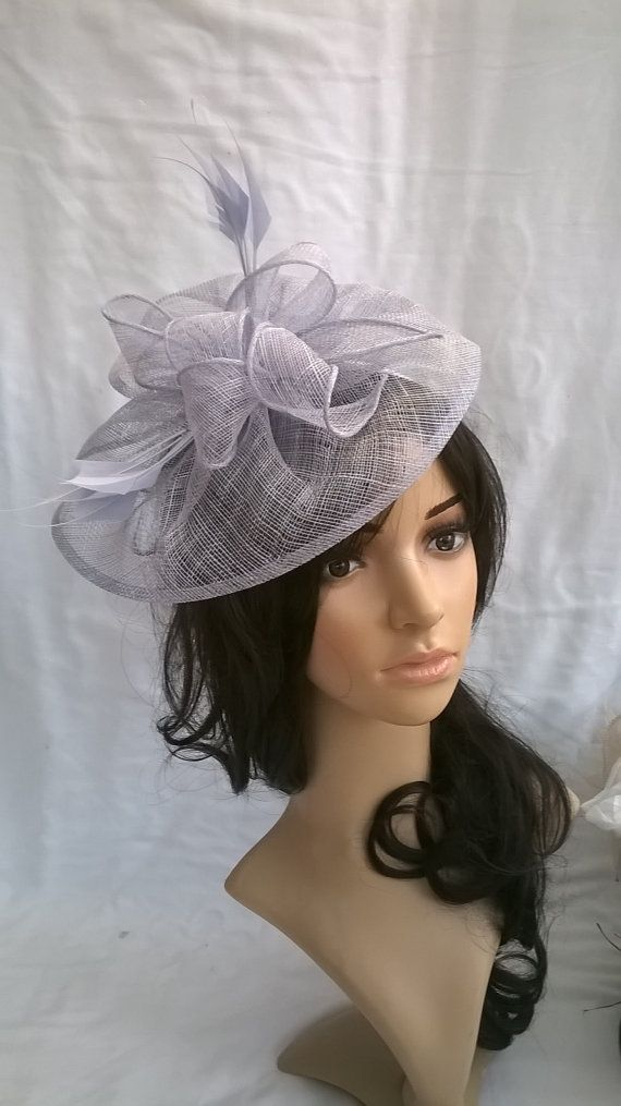 Lavender Blue sinamay fascinator ..styled with swirls,petals & diamond cut feathers #fascinatorstyles