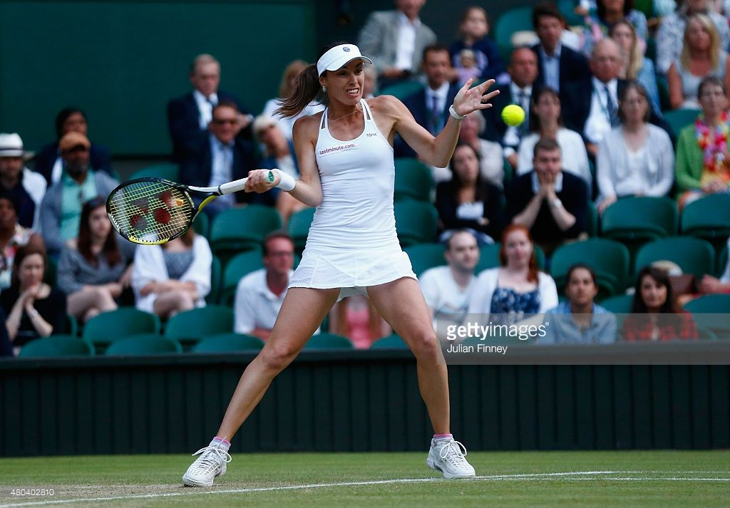 Martina Hingis of Switzerland plays a forehand in the Final Of The Ladies' Doubles with Sania Mirza of India against Ekaterina Makarova of Russia and Elena Vesnina of Russia during day twelve of the Wimbledon Lawn Tennis Championships at the All England Lawn Tennis and Croquet Club on July 11, 2015 in London, England.