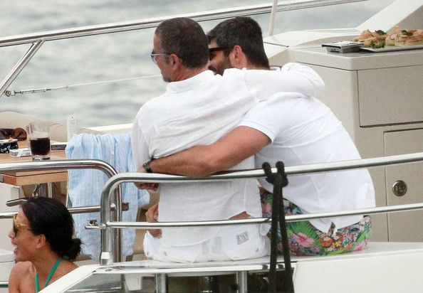 Fadi Fawaz Photos Photos - Singer George Michael and boyfriend Fadi Fawaz are seen cuddling and holding hands while on board a boat with some friends at Sydney Harbour in Sydney. - George Michael and Fadi Fawaz Cuddle in Sydney