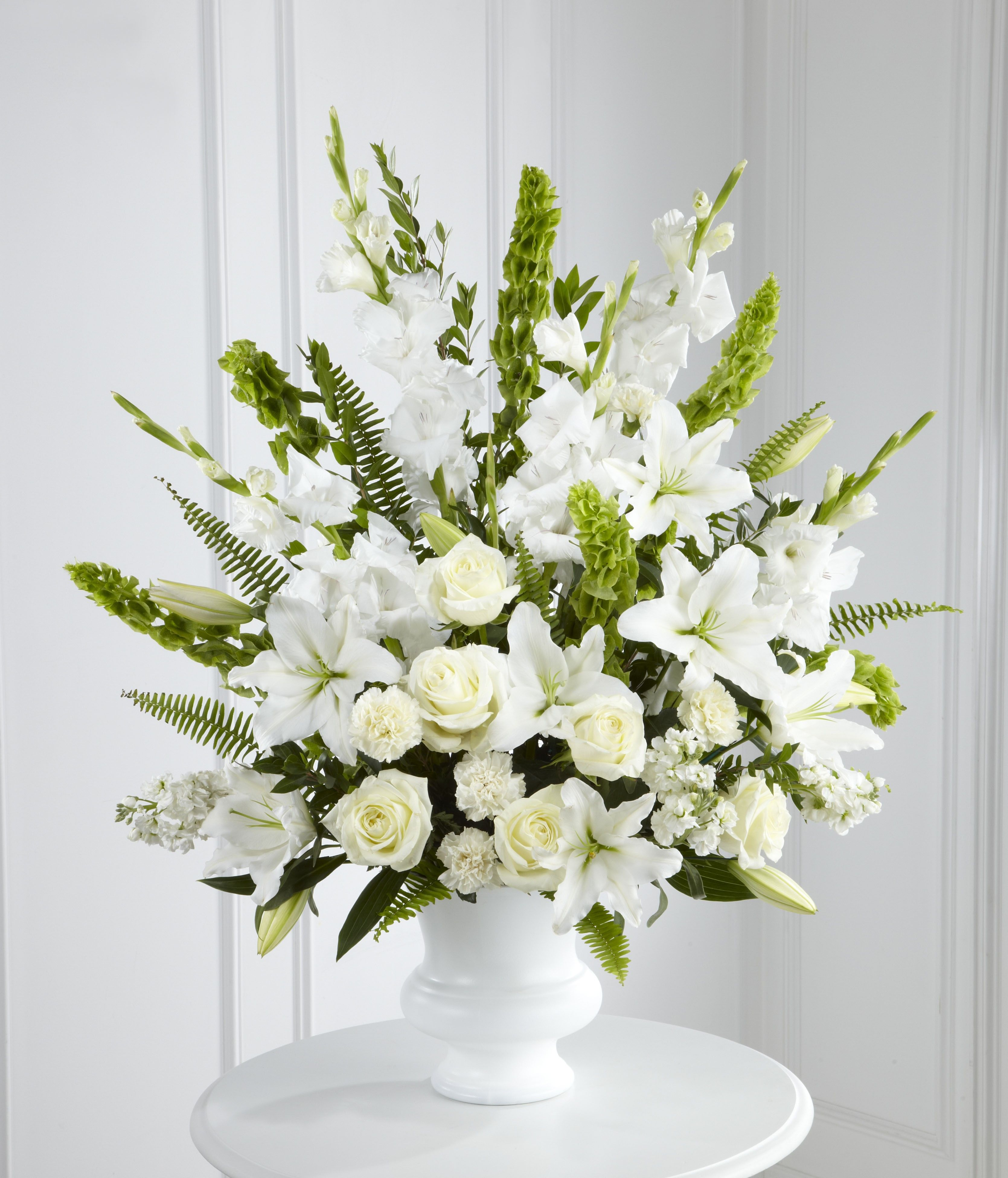 Gladiolus white lisianthus and snapdragons could look nice for funeral flowers izmirmasajfo Images