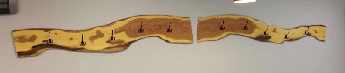 """Coat rack made from two 6ft by 1/2"""" thick mesquite boards. Finished in clear polyurethane."""