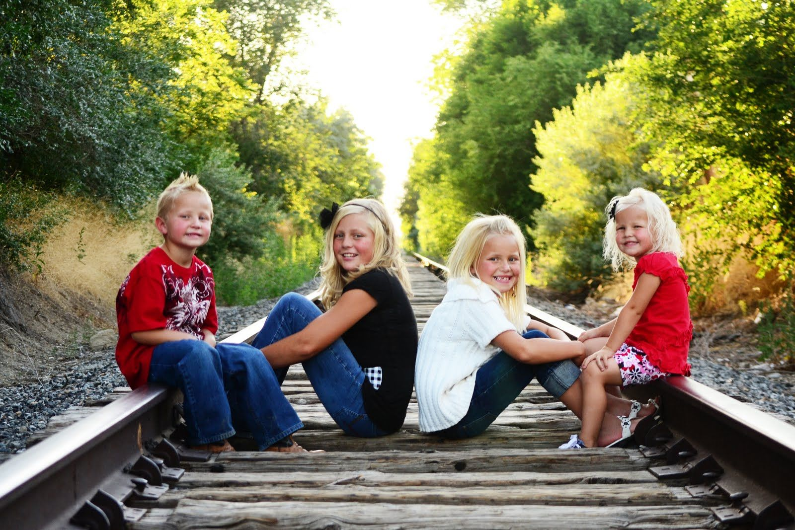 Photography family Poses On Railroad Tracks | Email This BlogThis! Share to Twitter Share to Facebook #grandkidsphotography