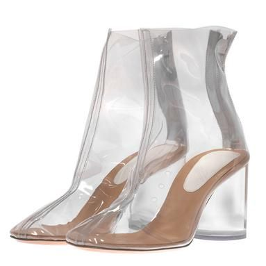 Maison Martin Margiela black boot from Spring / Summer 2012 Runway Collection. Clear PVC plastic ankle boot with round heel, interior zipper, and signature Margiela white stitch at back. Heel height measures apporoximatey 3.25 inches. (Eeewww! Smooshed feet are not pretty...)