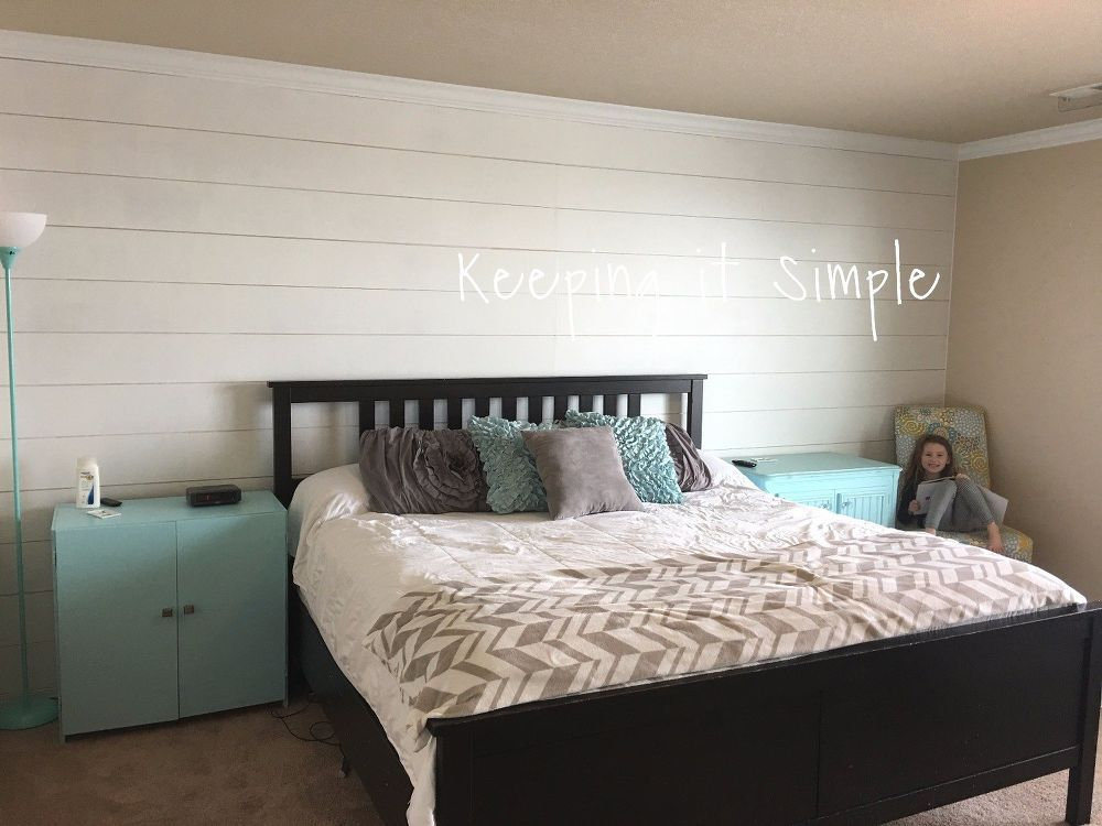 shiplap wall in the master bedroom for