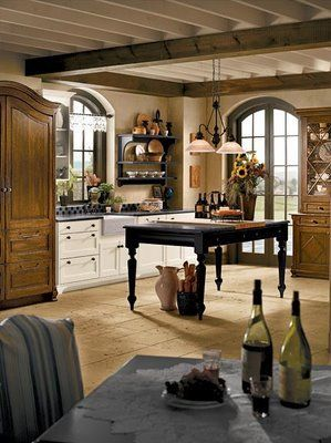 French kitchens use different pieces of furniture alongside non-matching cabinets