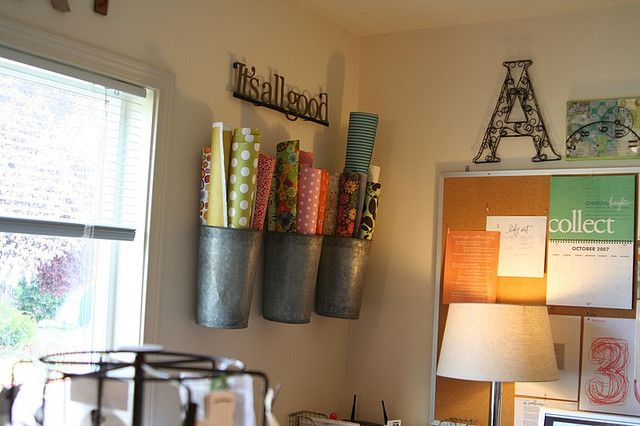 Using vertical space and decorating at the same time.  I have buckets with paper rolls but never thought to put them on the wall. Love it! Ali Edward's studio.