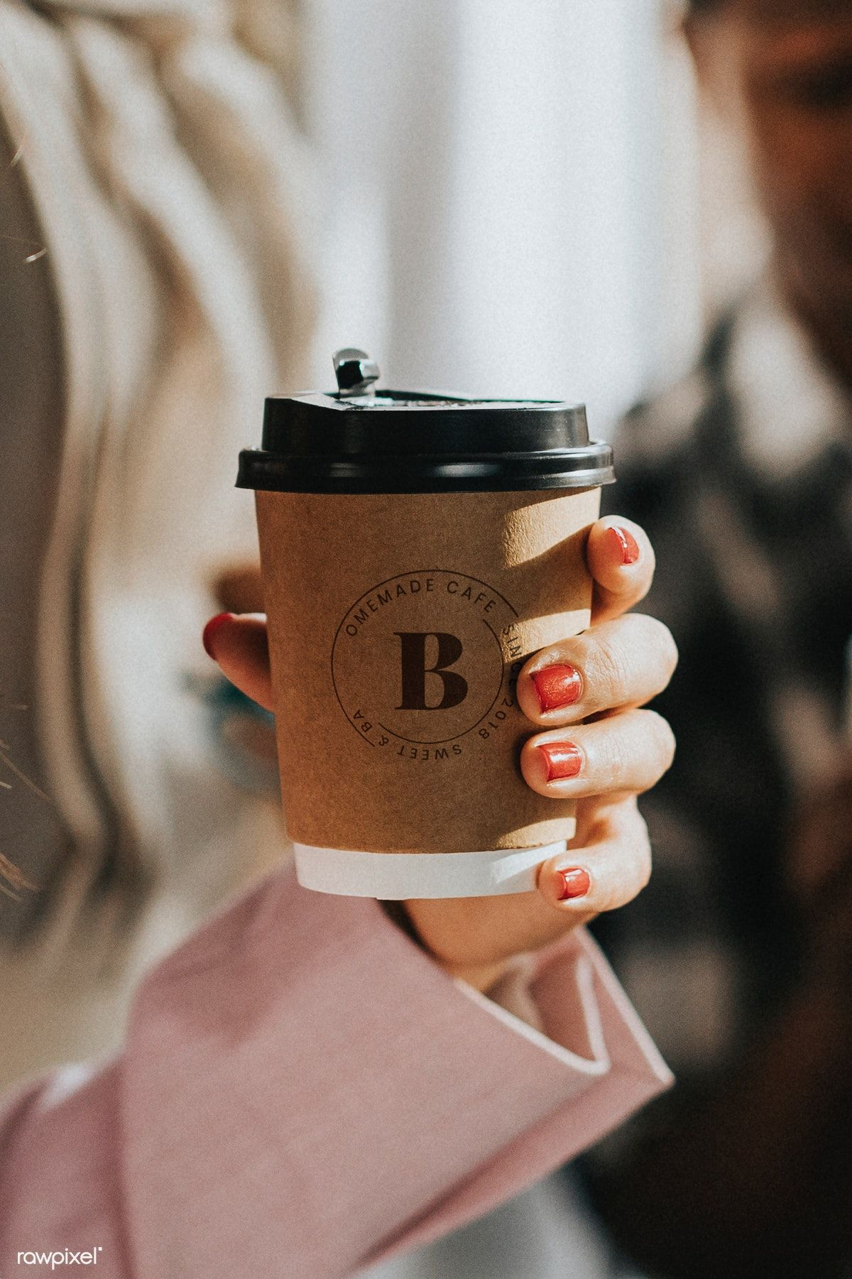 Download premium image of Female hand holding a coffee cup