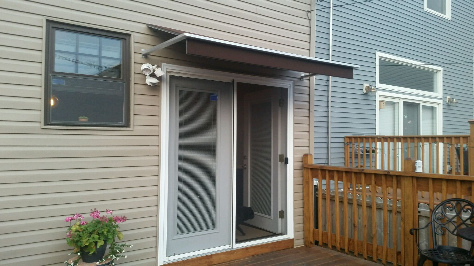 Custom awning over sliding glass entry door- a doublewide ...