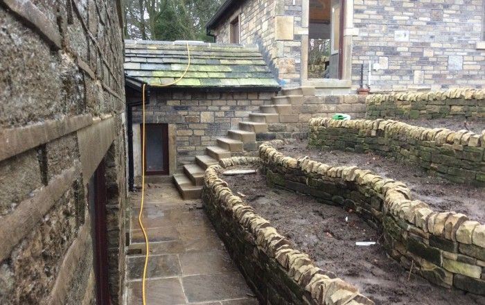 Yorkstone Used For Dry Stone Walling In A Terraced Garden