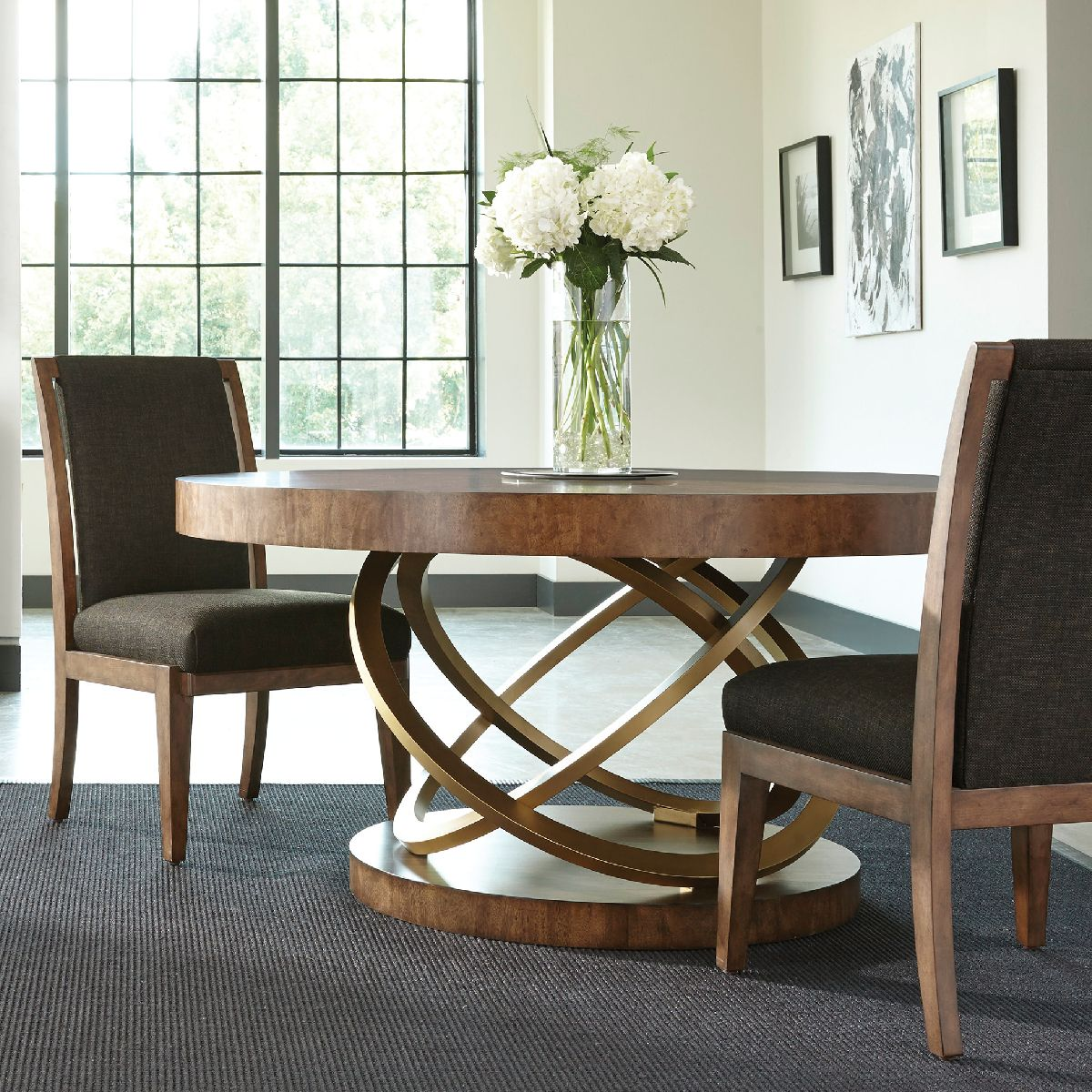 Put A Modern Twist On Your Dining Room The Round Dining Table Is Stunning Heritage Dining Room Furniture Design Inspiration