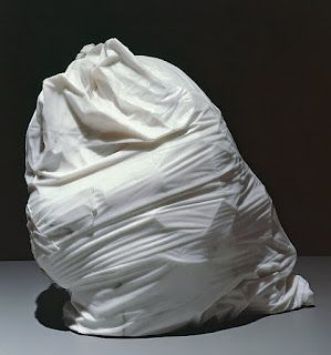 A marble sculpture of a bag of trash.