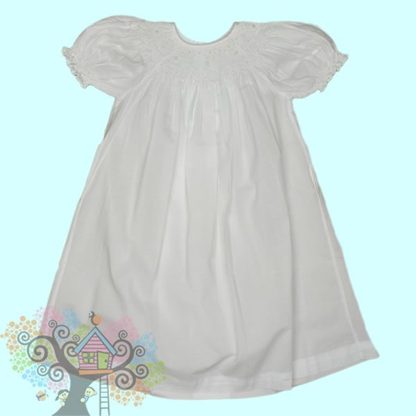 Beautiful White Smocked Bishop Dress with Pearl colored beads.  Visit www.hidenseekboutique.com to order