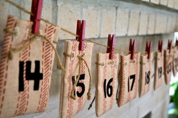 striped-ticking drawstring bags as advent calendar from thewashroom shop on etsy