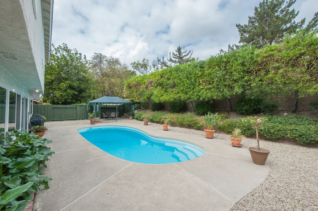Traditional Swimming Pool With Pea Gravel, Concrete Patio Construction