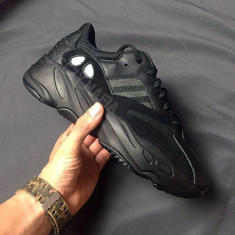 4f587db16bc23 YEEZY BOOST 700s in Triple Black   White