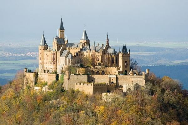 A castle with a gorgeous view -  Hohenzollern Castle in Germany. Home to Prussian kings and German emperors, thought to have originally been built in 1061, though recorded history exists. It was bought in 1819 by Frederick William IV, who fully restored it. The view from the top is spectacular as you can see.