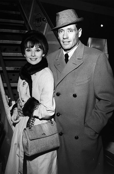 Audrey Hepburn photographed with her husband Mel Ferrer at the Idlewild Airport in New York (USA), prior to boarding a TWA SuperJet for Los Angeles, California (USA), on December 12, 1961.