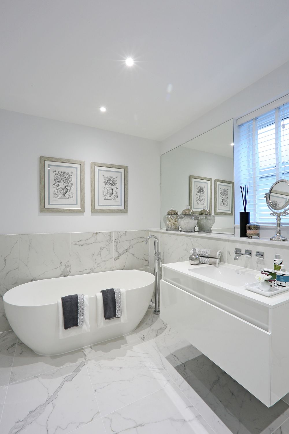 Half tiled marble-effect walls and floor create a dramatic footprint ...