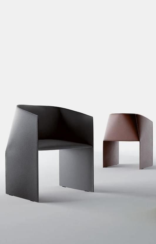 Plau | Design by Panzeri Team Design. Comfortable and enveloping, the Plau chair takes the form of a single flat padded sheet, cut and folded to form a bucket-style seat. Covered in fabric or leather in different colors and in different heights.