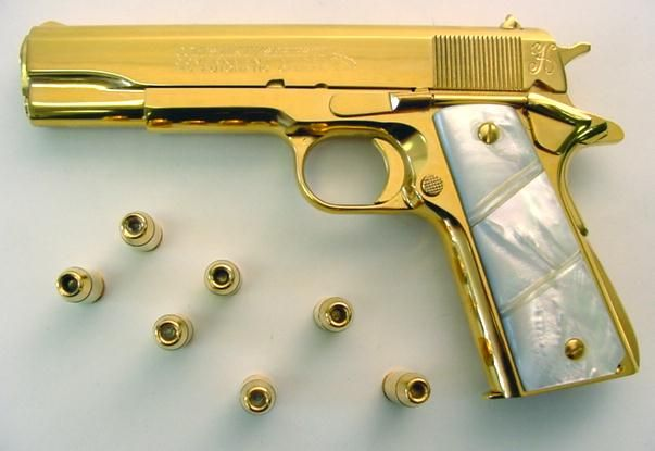 louis vuitton 1911 grips. golden colt 1911 with pearl grips.someone has too much money. louis vuitton grips n