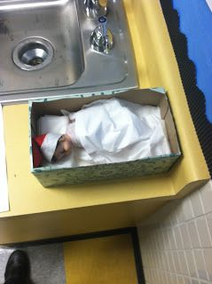 Elf on the Shelf:  Sleeping in a baking pan covered up with napkins or paper towels